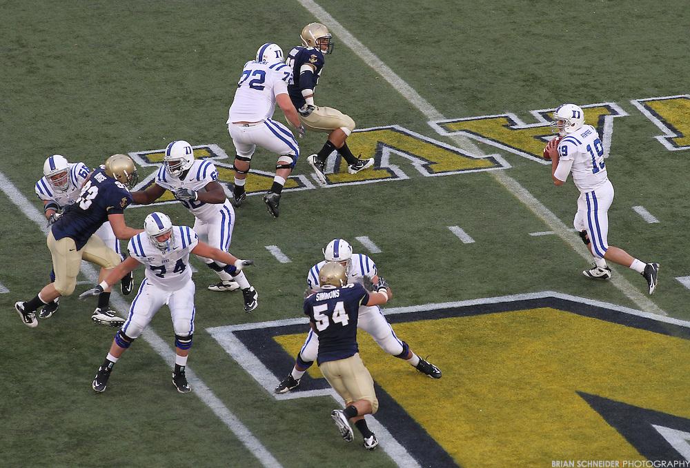 Oct 30, 2010; Annapolis, MD, USA; Duke Blue Devils quarterback Sean Renfree (19) scrambles against the Navy Midshipmen during the second half at Navy-Marine Corp Memorial Stadium. Mandatory Credit: Brian Schneider-www.ebrianschneider.com