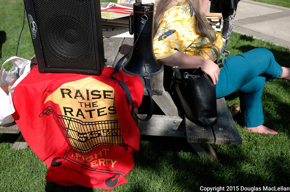 Windsor, Canada. 22 May 2015. -- A speaker, megaphone and Raise the rates sign on a table prior to the start of a rally at City Hall. -- The Raise the Rates campaign made a stop in Windsor Canada for a town hall meeting and rally. The campaign is an anti-austerity fight against the Ontario government's reducing of social welfare payments and the bungled Social Assistance system.