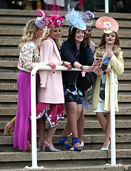 Female racegoers pose for a picture during Ladies Day of the 2018 Cheltenham Festival at Cheltenham Racecourse. PRESS ASSOCIATION Photo. Picture date: Wednesday March 14, 2018. See PA story RACING Cheltenham. Photo credit should read: Steven Paston/PA Wire. RESTRICTIONS: Editorial Use only, commercial use is subject to prior permission from The Jockey Club/Cheltenham Racecourse.