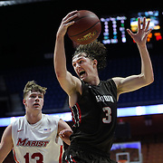 Steven Spieth, Brown, rebounds while challenged by Kristinn Palsson, Marist, during the Marist vs Brown Men's College Basketball game in the Hall of Fame Shootout Tournament at Mohegan Sun Arena, Uncasville, Connecticut, USA. 22nd December 2015. Photo Tim Clayton