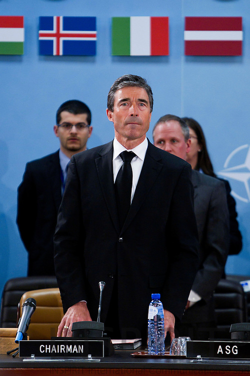 BRUSSELS - BELGIUM - 12 APRIL 2010 -- NATO Secretary General Anders Fogh Rasmussen looks up, moments before the North Atlantic Council holds a minute of silence at NATO headquarter in Brussels, Monday April 12, 2010. Polish President Lech Kaczynski and some of the country's highest military and civilian leaders died on Saturday, when the presidential plane crashed as it came in to land in fog near Smolensk, western Russia. Photo: Erik Luntang/INSPIRIT Photo..