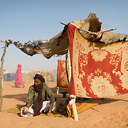 According to his identity card, Houmou Ag Mamili was registered as having arrived in the the Mbera camp for Malian refugees in Mauritania on 14 November 2013. As of 11 March 2013, when this photograph was taken, he had still not received a tent in which to live. According to Houmou he has repeatedly been told that there are no tents available, but that he should keep checking back.