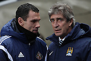 Manuel Pellegrini, manager of Manchester City and Gus Poyet manager of Sunderland, prior to the Barclays Premier League match against Sunderland at the Etihad Stadium, Manchester.<br /> Picture by Michael Sedgwick/Focus Images Ltd +44 7900 363072<br /> 01/01/2015