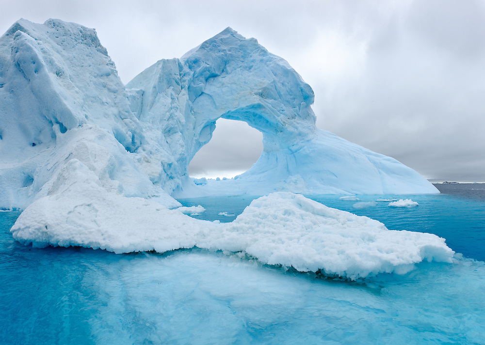 Icebergs in Antarctica are constantly changing their shape, molded by the strong winds and roaring seas.