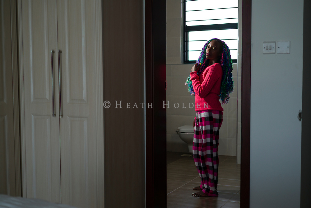 Muthoni Gitau works on her new braid style at her home in Nairobi, Kenya on Thursday 19th of September.