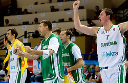 Goran Jagodnik (12) of Slovenia and Primoz Brezec (7) of Slovenia celebrate  during the basketball match at 1st Round of Eurobasket 2009 in Group C between Slovenia and Serbia, on September 08, 2009 in Arena Torwar, Warsaw, Poland. Slovenia won 84:76. (Photo by Vid Ponikvar / Sportida)