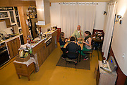 Vegetarian teenager Coco Simone Fincken (right) enjoys dinner with her family at their home in the city of Gatineau, Quebec, Canada. (Featured in the book What I Eat: Around the World in 80 Diets.) The caloric value of Coco's day's worth of food on a typical day in the month of October was 1900 kcals. She is 16 years of age; 5 feet, 9.5 inches tall; and 130 pounds. The family doesn't own a car, buys organic food if it's not too expensive, and grows some of their own vegetables in their front yard. MODEL RELEASED.