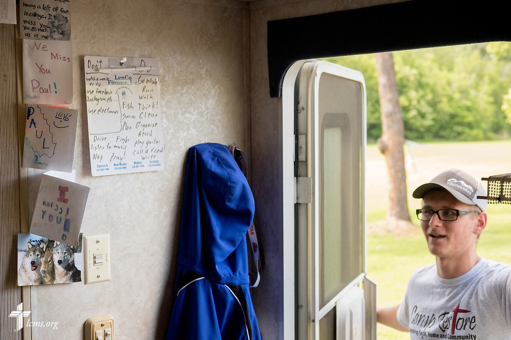 Young Adult Corps participant Paul Mroczenski stops by his camper on Tuesday, April 3, 2018, at Camp Restore in Baton Rouge, La. Posted on the wall are encouragement notes from students and friends and family. LCMS Communications/Erik M. Lunsford