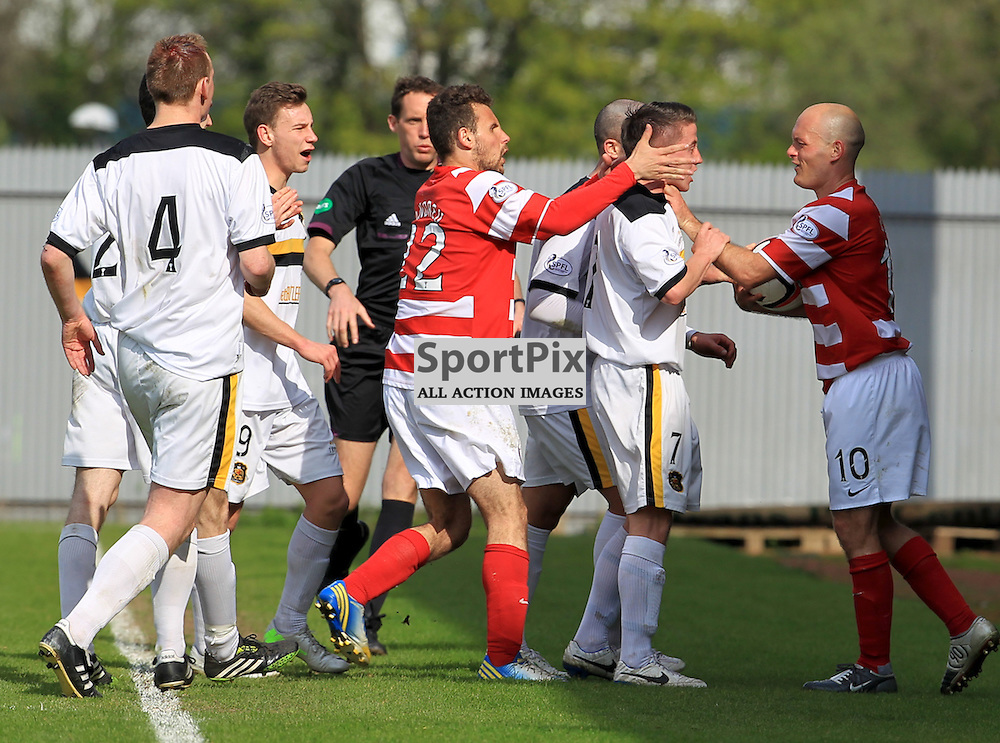 Alex Neil grabs Mark Gilhaney by the throat  on the touchline during the Dumbarton FC  V Hamilton Academical FC  Scottish Championship  26th April 2014 ©Edward Linton | SportPix.org.uk