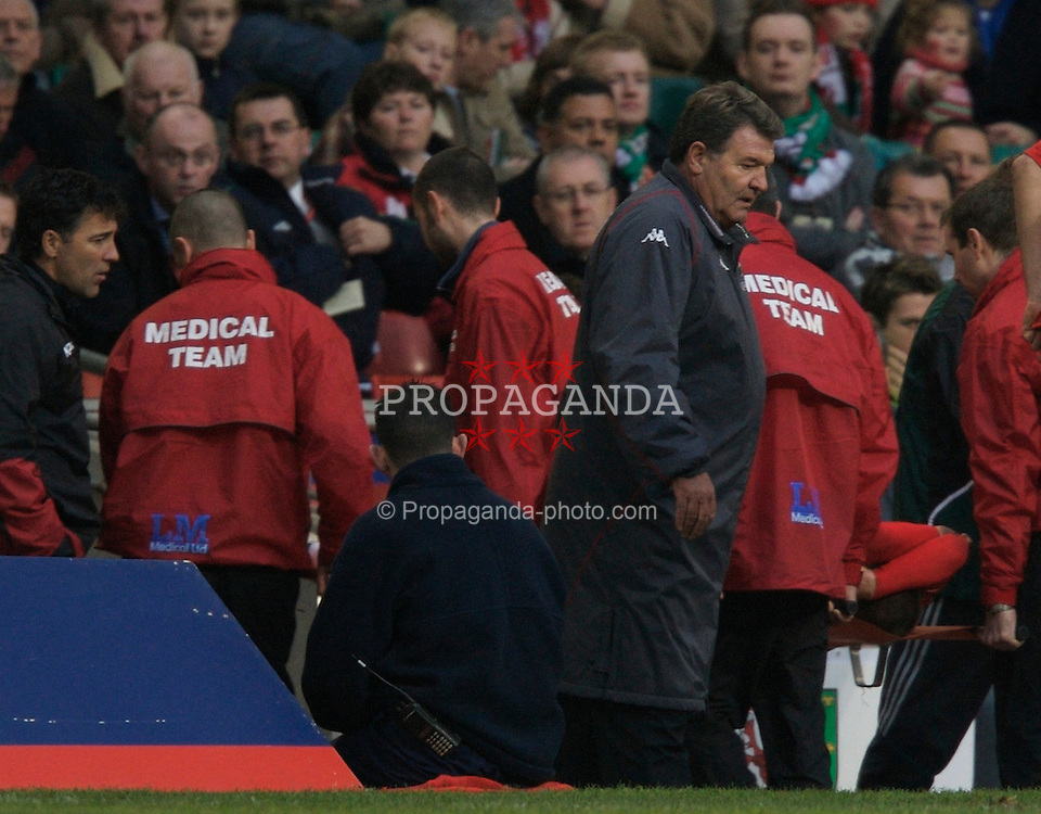 CARDIFF, WALES - Saturday, November 17, 2007: Wales' Carl Robinson is carried off injured against Republic of Ireland as manager John Toshack looks on during the UEFA Euro 2008 Qualifying Group D match at the Millennium Stadium. (Pic by David Rawcliffe/Propaganda)