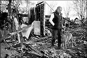 ((EDITORS NOTE: Photo caption ran as monthly photo column series Viewfinder, entered here as a portrait))..For Leo (above, with his dog Harvey) and Alice Montaño, starting over.after the home they lived in the past 35 years burned to the ground.must truly be one of those times...Leo, 82, and Alice 77, lost the family home that Leo built to a fire.on Jan. 10, 2007. Investigators suspect a cord lighting the Christmas.tree was most likely to blame.