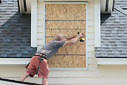 A carpenter covers windows with plywood in preparation for Hurricane Irma in the beach community of Isle of Palms September 7, 2017 in Isle of Palms, South Carolina. Imra is packing winds of 185-mph making it the strongest hurricane ever recorded in the Atlantic Ocean and has already caused devastation in the Caribbean.