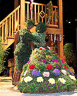 """Robertson's Flowers """"Festival of Flowers """" display is shown at the Pennsylvania Horticultural Society 2003 Philadelphia Flower Show, March 1, 2003, in Philadelphia, Pennsylvania. The theme for this years show is """"Festival de las Flores,"""" and features Latin rhythms, brilliant colors, flambojan trees, passion flowers, and a host of exotic flora combined with world class horticulture competitions. The show, which is the world's largest indoor flower show, runs through March 9, 2003. (Photo by Tina Sottolano/photodx.com)"""