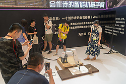 June 15, 2018 - Shanghai, Shanghai, China - Shanghai, CHINA-15th June 2018: A poem writing machine can be seen at the 1st Shanghai International Cultural Equipment Expo in Shanghai, east China's Shandong Province, June 15th, 2018. People can feel World Cup atmosphere everywhere in Qingdao including bars, hotels and restaurants. (Credit Image: © SIPA Asia via ZUMA Wire)