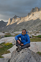 Hiker enjoying the view in Titcomb Basin, Bridger Wilderness, Wind River Range Wyoming