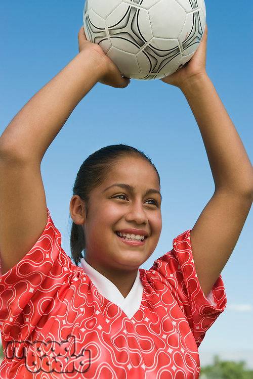 Smiling Girl Throwing in Soccer Ball