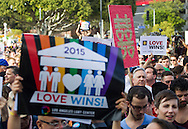 Same-Sex Marriage supporters gather for a rally celebtaing the US Supreme Court decision legalizing same-sex marriage, in West Hollywood, California on June 26, 2015. The U.S. Supreme Court declared that same-sex couples have a right to marry anywhere in the country, in a dramatic culmination of two decades of litigation over marriage, and gay rights in general. Gay and lesbian couples already could marry in California and 35 other states and the District of Columbia. The court's 5-4 ruling means the remaining 14 states, in the South and Midwest, will have to stop enforcing their bans on same-sex marriage.  (Photo by Ringo Chiu/PHOTOFORMULA.com)