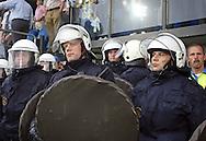 15-05-2008 Voetbal:RKC Waalwijk:ADO Den Haag:Waalwijk<br /> De ME politie kijkt aan de rand van de kleedkamers toe hoe de supporters te keer gaan in het stadion<br /> Foto: Geert van Erven