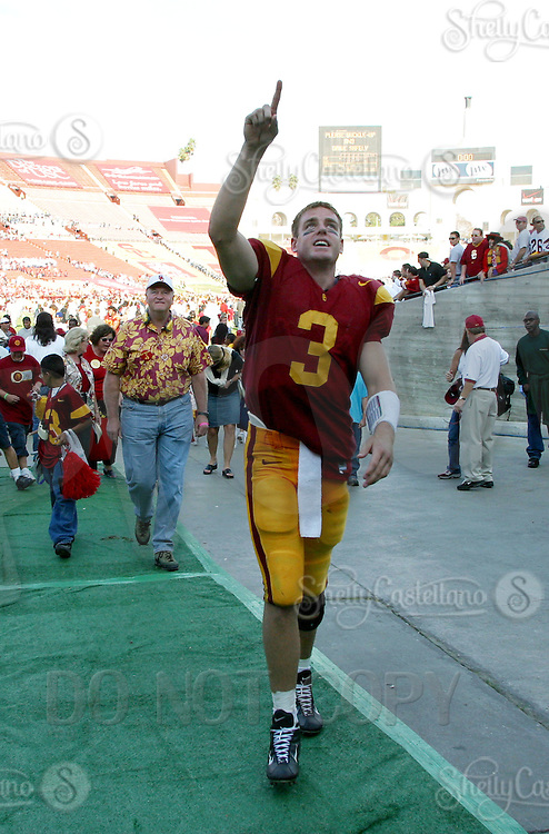 19 October 2002: QB #3 Carson Palmer of the USC Trojans college football team points to fans near the tunnel after a 41-21 win over Washington Huskies. Pac-10 College Football at the LA Coliseum. &amp;#xA;<br />