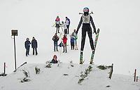 Ayla Weale U16 Lebanon Outing Club hitting the K20 jump at Gunstock Nordic Associations ski jump event held on Saturday morning.  (Karen Bobotas/for the Laconia Daily Sun)