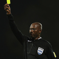 Referee Mr Victor Hlungwani showing Thabiso Semenya of Polokwane City a yellow card during the 2016 Premier Soccer League match between Maritzburg Utd and Polokwane City held at the Harry Gwala Stadium in Pietermaritzburg, South Africa on the 27th September 2016<br /> <br /> Photo by:   Steve Haag / Real Time Images