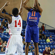 Westchester Knicks Guard Langston Galloway (11) takes a jump shot as Delaware 87ers Forward Malcolm Lee (14) defends in the first half of a NBA D-league regular season basketball game between the Delaware 87ers and the Westchester Knicks (New York Knicks) Sunday, Dec. 28, 2014 at The Bob Carpenter Sports Convocation Center in Newark, DEL