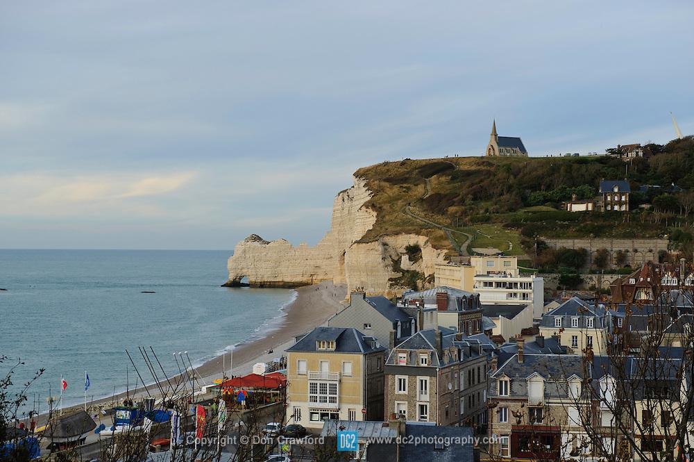 Cliffs, beach and seaside town Etretat France.