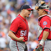 NEW YORK, NEW YORK - July 10: Pitcher Jonathan Papelbon #58 of the Washington Nationals celebrates the save with Wilson Ramos #40 of the Washington Nationals during the Washington Nationals Vs New York Mets regular season MLB game at Citi Field on July 10, 2016 in New York City. (Photo by Tim Clayton/Corbis via Getty Images)