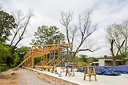 The Rural Studio Fabrication Pavilion under construction beside the White-Morrisette House.