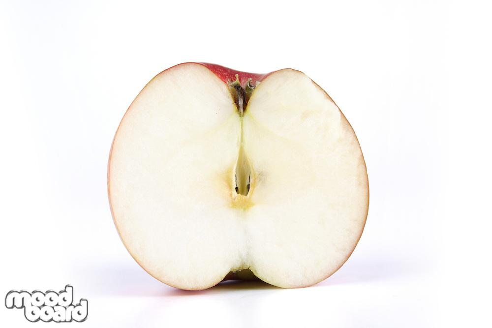 Halved apple on white background