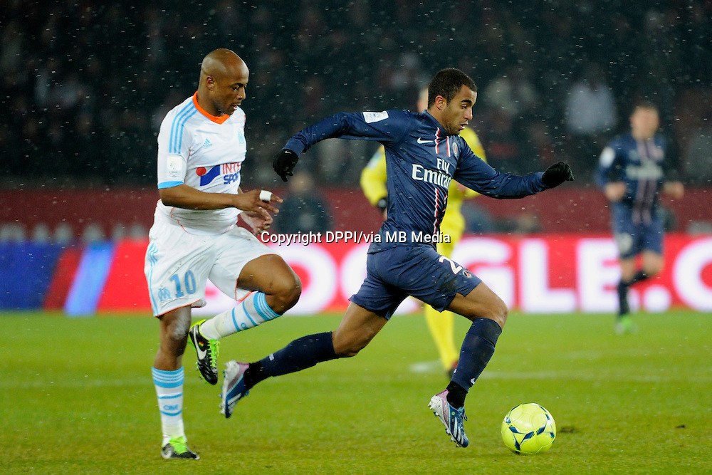 FOOTBALL - FRENCH CHAMPIONSHIP 2012/2013 - L1 - PARIS SAINT GERMAIN v OLYMPIQUE MARSEILLE - 24/02/2013 - PHOTO JEAN MARIE HERVIO / REGAMEDIA / DPPI - LUCAS MOURA (PSG) / ANDRE AYEW (OM)