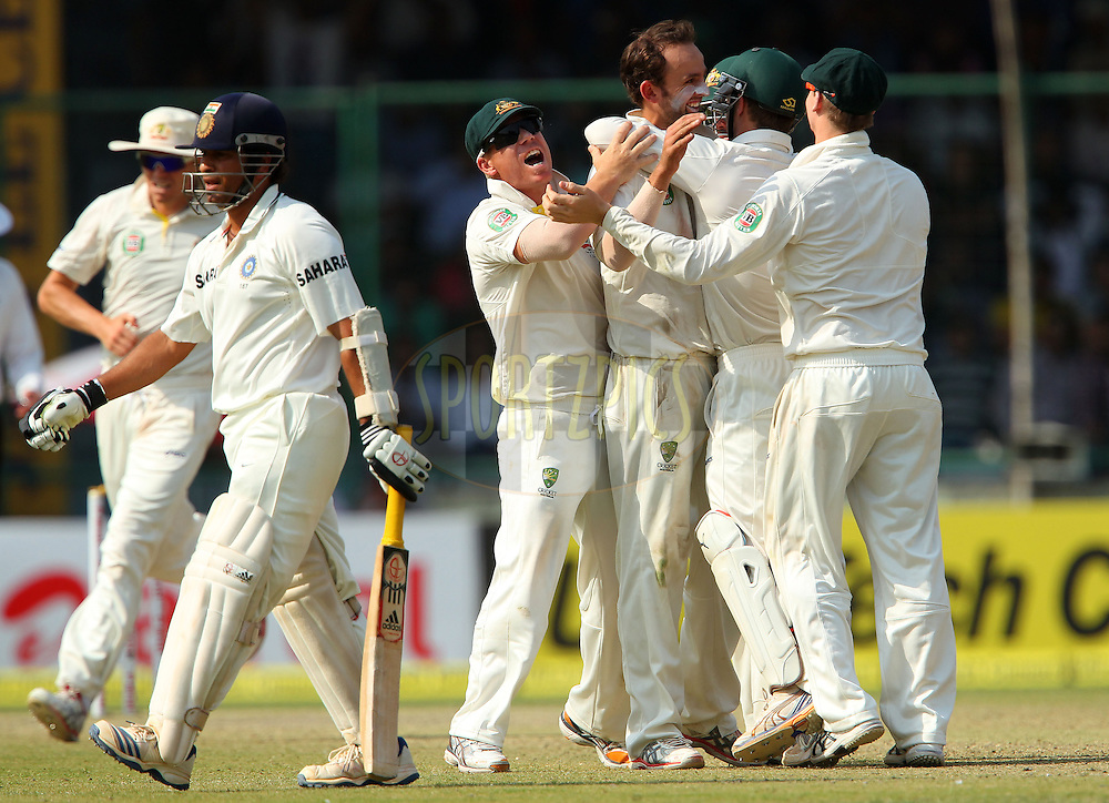 Nathan Lyon of Australia celebrates the wicket of Sachin Tendulkar of India during day 2 of the 4th Test Match between India and Australia held at the Feroz Shah Kotla stadium in Delhi on the 23rd March 2013..Photo by Ron Gaunt/BCCI/SPORTZPICS ..Use of this image is subject to the terms and conditions as outlined by the BCCI. These terms can be found by following this link:..http://www.sportzpics.co.za/image/I0000SoRagM2cIEc