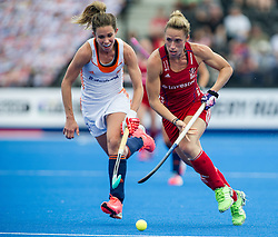 Great Britain's Susannah Townsend goes past Ellen Hoog of the The Netherlands. Great Britain v The Netherlands - Hockey Champions Trophy,  Lee Valley Hockey & Tennis Centre, London, UK on 19 June 2016. Photo: Simon Parker