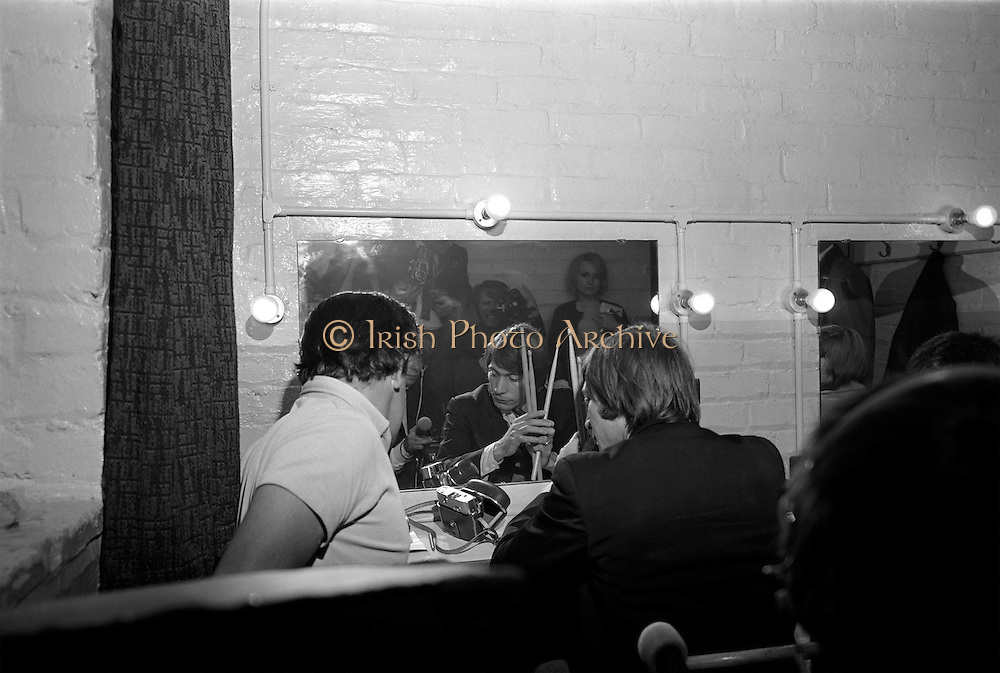 The Rolling Stones Charlie is my Darling; Ireland 1965 -Drummer Charlie Watts of The Rolling Stones waiting in his dressing room before going onstage at the Adelphi Theater, Middle Abbey Street, Dublin. This was the band's second Irish tour of 1965. The Rolling Stones Charlie is my Darling- Ireland 1965.Out November 2nd from ABKCO. Super Deluxe Box Set/Blu-ray and DVD Details Revealed. <br />