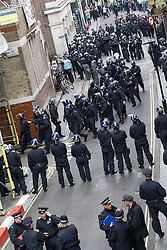 "© Licensed to London News Pictures . 11/06/2013 . London , UK . Police surround a former police station on 40 Beak Street , Soho this morning (11th June) which has been occupied by organisers as a base for today's "" Stop G8 "" anti capitalist protest . Demonstrations in London today (Tuesday 11th June 2013) ahead of Britain hosting the 39th G8 summit on 17th/18th June at the Lough Erne Resort , County Fermanagh , Northern Ireland , next week . Photo credit : Joel Goodman/LNP"
