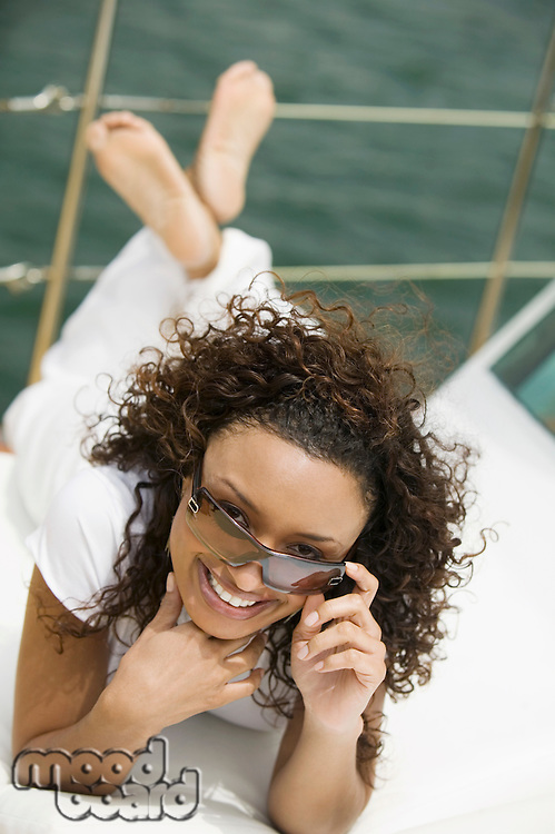 Woman Using Cell Phone on Boat