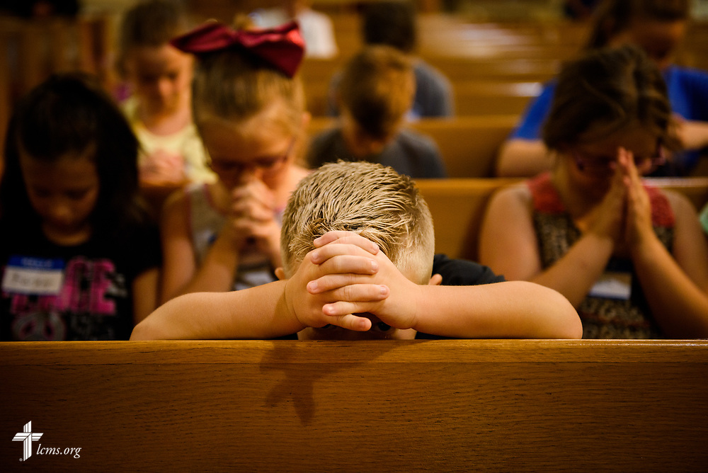 A boy prays during Camp Courage VBS at Zion Lutheran Church on Thursday, July 13, 2017, in Ottawa, Ill. The VBS resource is available from LCMS Disaster Response.  LCMS Communications/Erik M. Lunsford