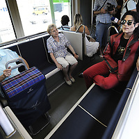 "Two women look at actor Fran Jackson (R) as he travels in tram, on September 2, 2010, in the Northern Spanish city of Bilbao. Actors and dancers, dressed up like zombies, visited Bilbao to promote the musical show ""Forever, King of Pop"", based on Michael Jackson's ""Thriller"". PHOTO/Rafa Rivas"