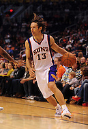 Oct. 22 2010; Phoenix, AZ, USA; Phoenix Suns point guard Steve Nash (13) drives the ball during the first half against Denver Nuggets during a preseason game at the US Airways Center. Mandatory Credit: Jennifer Stewart-US PRESSWIRE.