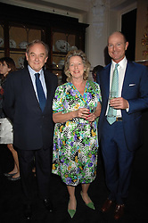 Left to right, MR ADRIAN & the HON.MRS WHITE she is the daughter of the late Lord Howard de Walden and HRH PRINCE DIMITRI OF YUGOSLAVIA at a reception to celebrate the launch of Prince Dimitri of Yugoslavia's one-of-a-kind jeweleery collection held at Partridge Fine Art, 144-146 New Bond Street, London on 11th June 2008.<br />