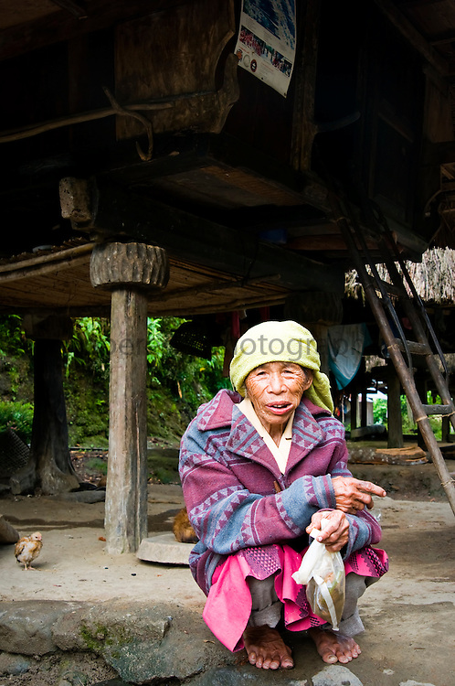 PHILIPPINES (Tam-an. Banaue. Province of Ifugao). 2009. Old woman in front of his house in the village of Tam-an, near Banaue.