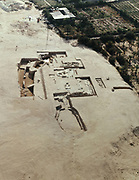 Barbar Temple II, aerial site photograph, constructed with cut limestone blocks, containing a sacrificial courtyard, altars, shrines and an underground shrine built around a fresh water spring, in the Bahrain National Museum, designed by Krohn and Hartvig Rasmussen, inaugurated December 1988 by Amir Shaikh Isa Bin Salman Al-Khalifa, in Manama, Bahrain. This large temple was discovered near the village of Barbar and the site consists of 3 successive temples, with the 2 oldest temples terraced with a central platform above an outer oval platform, in Sumerian style. The Bahrain National Museum houses cultural and archaeological collections covering 6000 years of history, with rooms entitled Burial Mounds, Dilmun, Tylos and Islam, Customs and Traditions, Traditional Trades and Crafts, and Documents and Manuscripts. Picture by Manuel Cohen