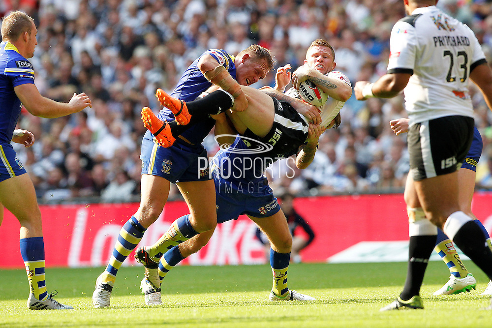 Hull's Steve Michaels gets the Ben Westwood treatment during the Challenge Cup Final 2016 match between Warrington Wolves and Hull FC at Wembley Stadium, London, England on 27 August 2016. Photo by Craig Galloway.