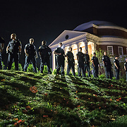 CHARLOTTESVILLE,VA-AUG11:Campus police at the University of Virginia following a march of hundreds of white nationalists and white supremacists carrying torches through the University of Virginia campus. Beginning a little after 9:30 p.m., the march lasted 15 to 20 minutes before ending in skirmishing when the marchers were met by a small group of counterprotesters at the base of a statue of Thomas Jefferson, the university's founder. (Photo by Evelyn Hockstein/For The Washington Post)