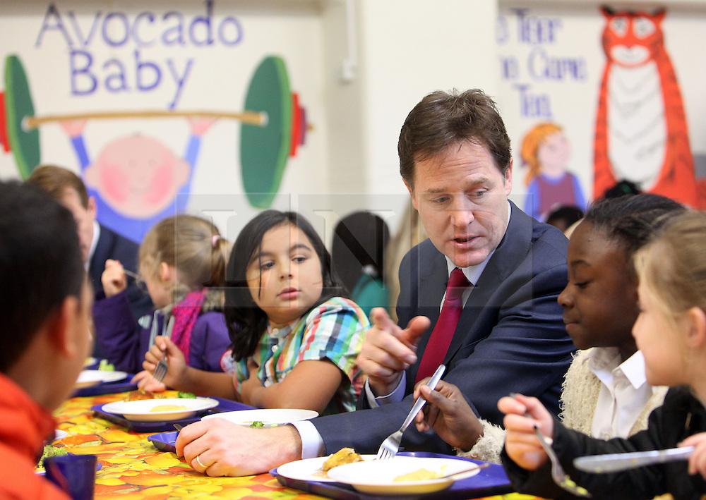 &copy; Licenced to London News Pictures. 04/12/2013. London. UK.  <br /> Deputy Prime Minister Nick Clegg is pictured eating lunch with children during his and schools minister David Laws' visit to the Walnut Tree Walk Primary School in London, December 4th 2013. The Deputy Prime Minister announced in September that one of his key priorities for the Autumn Statement was to provide free school meals to every infant school pupil.<br /> Photo Credit: Susannah Ireland
