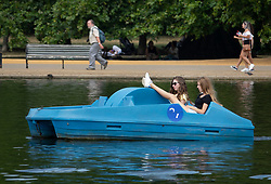 © Licensed to London News Pictures. 27/07/2018. London, UK. People ride pedal boats on the Serpentine in Hyde Park ahead of a break in the heatwave.  Rain is expected in parts of the south later. Photo credit: Peter Macdiarmid/LNP