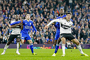 Fulham striker Aboubakar Kamara (47) and Fulham striker Aleksandar Mitrovic (9) hold off Leicester City players during the Premier League match between Fulham and Leicester City at Craven Cottage, London, England on 5 December 2018.