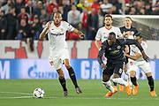 Sevilla midfielder Steven N'Zonzi (15) battles with Manchester United Forward Romelu Lukaku during the Champions League match between Sevilla and Manchester United at the Ramon Sanchez Pizjuan Stadium, Seville, Spain on 21 February 2018. Picture by Phil Duncan.
