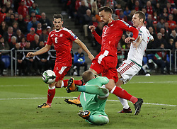BASEL, Oct. 8, 2017  Switzerland's Haris Seferovic (C) shoots past Hungary's goalkeeper Peter Gulacsi (bottom) during the FIFA World Cup 2018 Qualifiers Group B match between Switzerland and Hungary in Basel, Switzerland, Oct. 7, 2017. Switzerland won 5-2. (Credit Image: © Ruben Sprich/Xinhua via ZUMA Wire)
