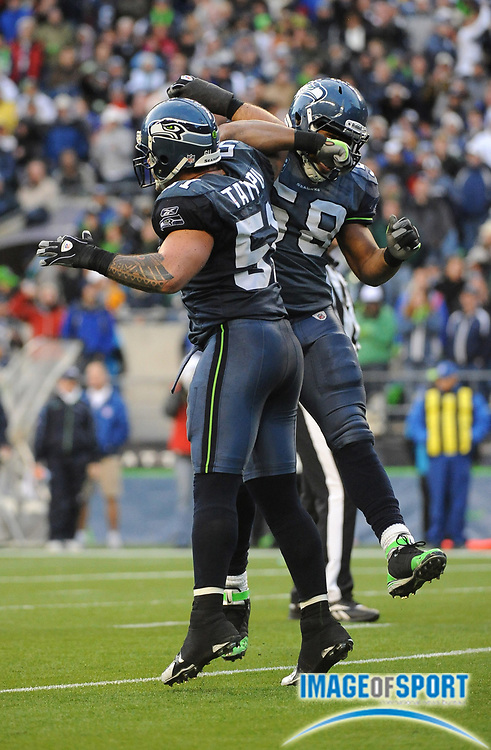 Dec 7, 2008; Seattle, WA, USA; Seattle Seahawks linebackers Lofa Tatupu (51) and D.D. Lewis (58) leap in celebration during the game against the New England Patriots at Qwest Field.